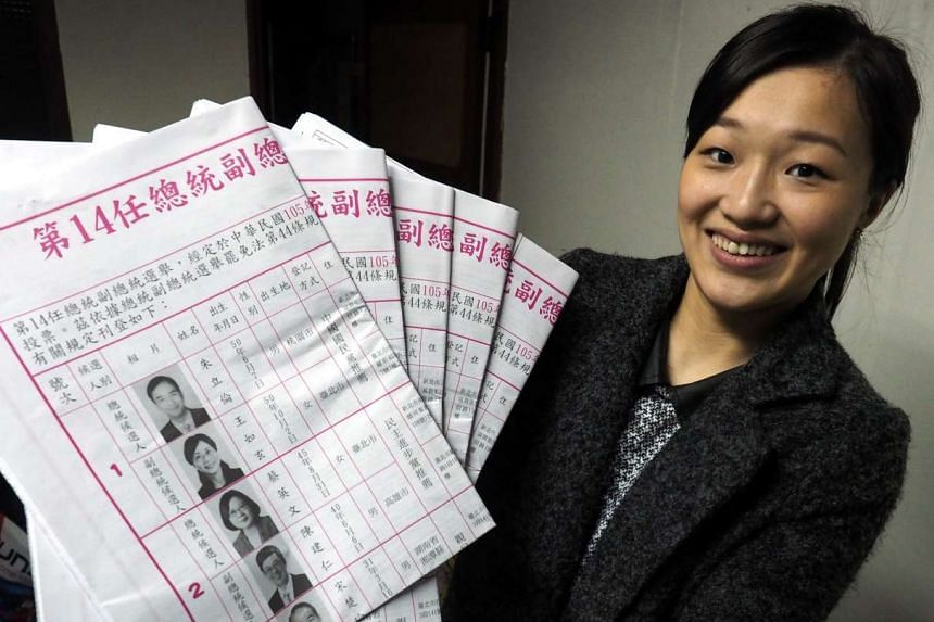 A woman displays election bulletins for the upcoming presidential elections in Taipei, Taiwan, on Jan 6, 2016.
