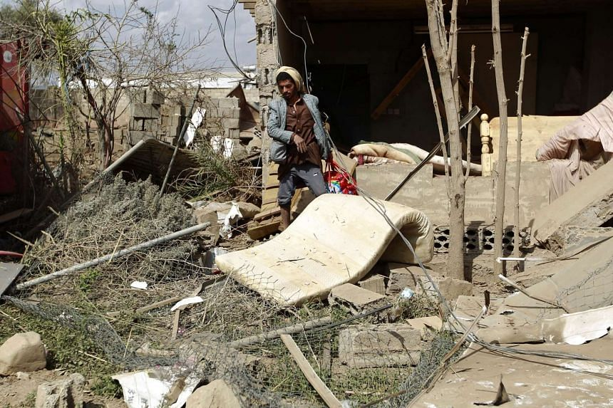 A Yemeni man inspects the damage at a site reportedly hit by Saudi-led airstrikes in the capital Sanaa on Jan 6, 2016.