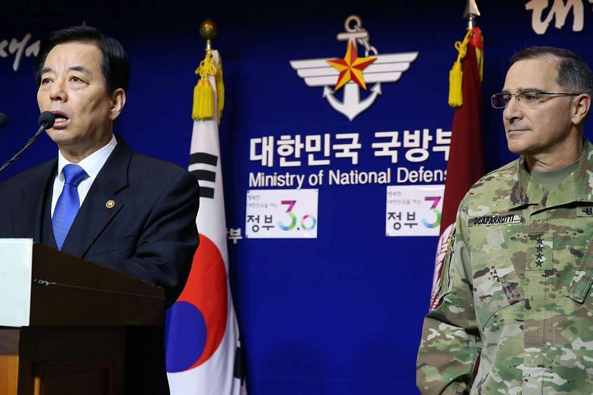 South Korea's Defence Minister Han Min Koo (left) alongside General Curtis Scaparrotti, commander of the US Forces Korea, announcing a South Korea-US joint press statement reaffirming the USA's defense commitment to Korea, in Seoul, South Korea, on J