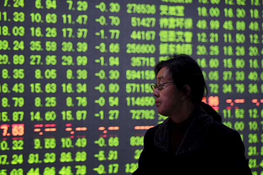 An investor at a brokerage house in Hangzhou, Zhejiang province, on Jan 7.