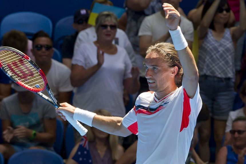Alexander Dolgopolov of Ukraine celebrates his victory against Lleyton Hewitt of the Australia Gold team during their match on Jan 7, 2016.