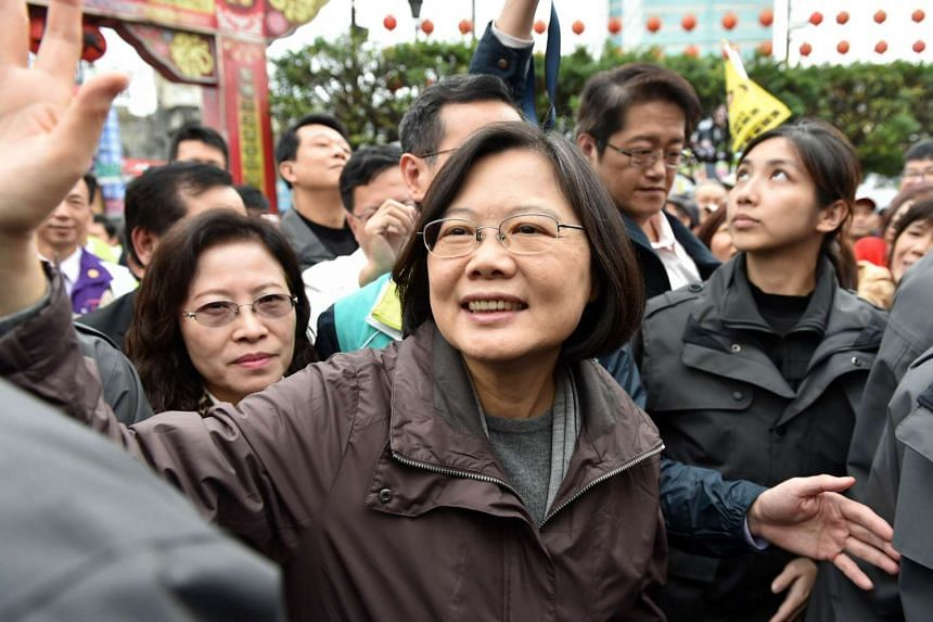 Ms Tsai Ing-wen (centre) waves to supporters at a local temple during an election campaign in northern Taoyuan on Jan 7, 2016.