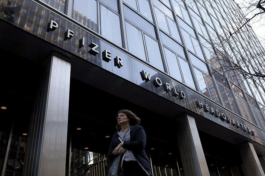 The Pfizer World Headquarters building in New York. The healthcare industry defied belief in 2015 with US$605 billion (S$867.7 billion) of takeovers. Among the mega deals, Pfizer agreed to buy Allergan, itself a prolific merger partner, for US$160 bi