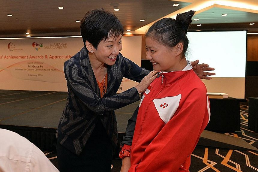 MCCY minister Grace Fu speaking with 15-year-old paddler Evelyn Lim, who is Singapore's youngest medallist at last month's Asean Para Games, during last night's Athlete's Achievement Award reception. The Republic's 156-strong APG contingent won a rec