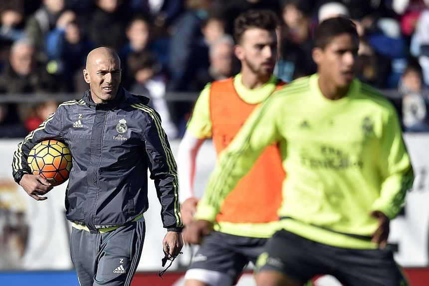 Zinedine Zidane (left) supervising a Real Madrid training session on Tuesday. The new manager is keen to keep all his star players happy and has reassured Welsh winger Gareth Bale, who was given a central role by previous boss Rafael Benitez, that he