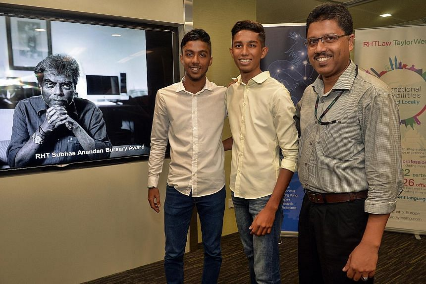 (From left) Abdul Khair and Muhammed Naasiruddin with their father Muhammed Zakkaria, who works as a dispatch clerk at RHTLaw Taylor Wessing. Mr Zakkaria's sons received the RHT Subhas Anandan Bursary Award.