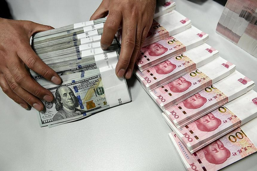 Analysts said the Chinese central bank's move could mean the yuan's value will now be set against a basket of currencies instead of just the United States dollar.