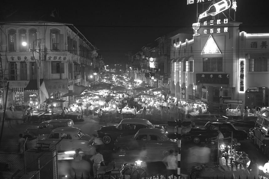 Hawker stalls along Pagoda Street in Chinatown in 1959.