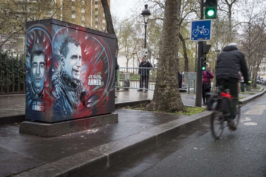 A piece of street art showing the portrait of French policeman Ahmed Merabet, who was killed in the attacks last year.