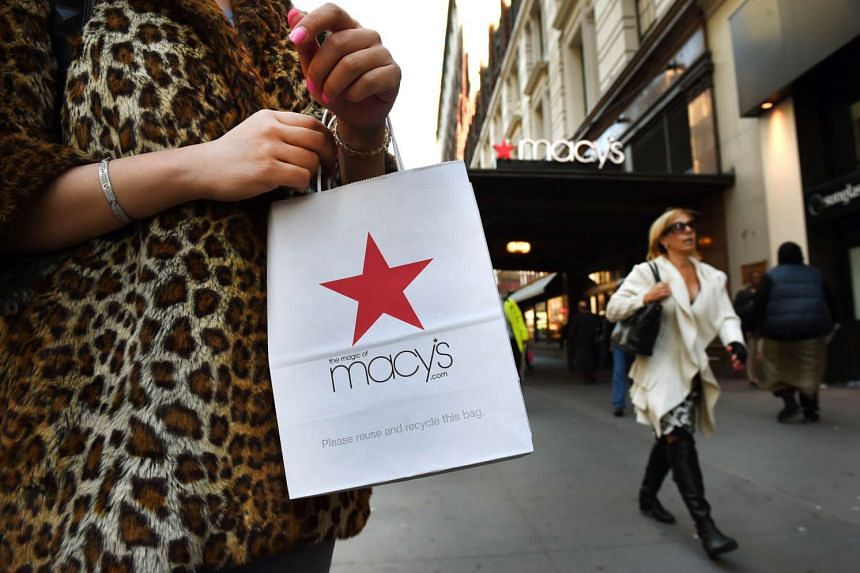 Shoppers are seen outside Macy's Herald Square in midtown Manhattan.