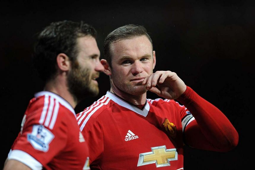 Manchester United's Wayne Rooney (right) and Juan Mata during a match against Swansea City on Jan 2, 2016.
