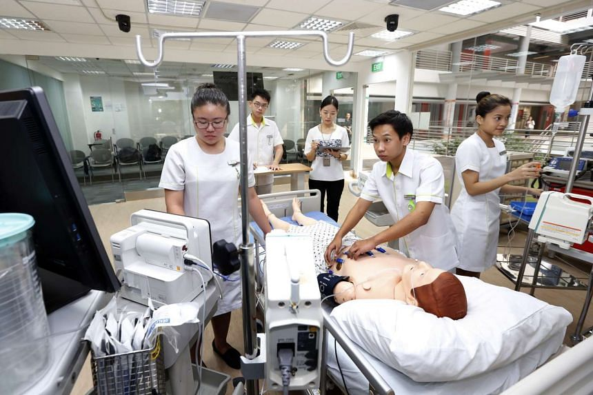 Lecturer Song Xiao (centre), watching over nursing students in the intensive care unit in Ngee Ann Polytechnic's School of Health Sciences.
