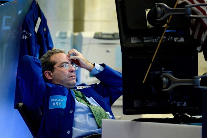 A trader works at the end of the trading day as the Dow Jones industrial average tanked again.