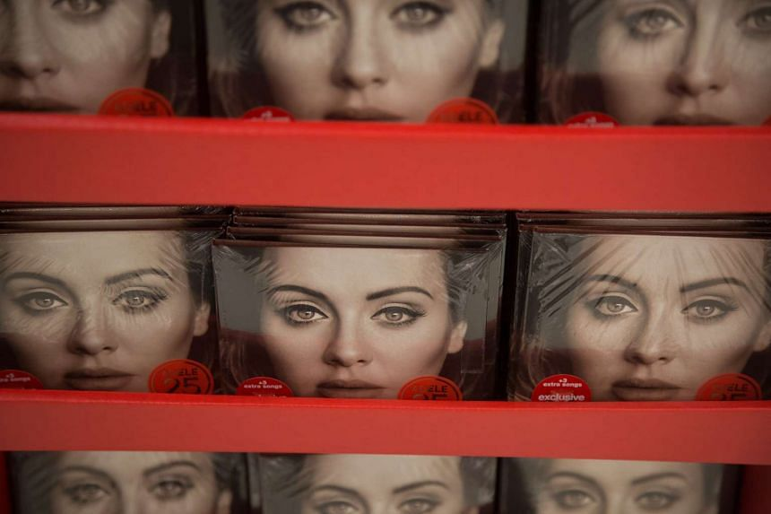 Copies of Adele's record-busting album 25 are displayed at a Target store in Jersey City, New Jersey on Nov. 27, 2015.
