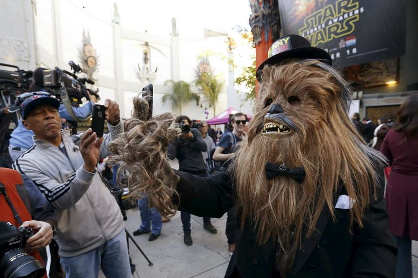 Anthony Troli, dressed as Chewbacca, takes a selfie before a Star Wars themed wedding at the TCL Chinese Theatre in Hollywood, California on Dec 17.