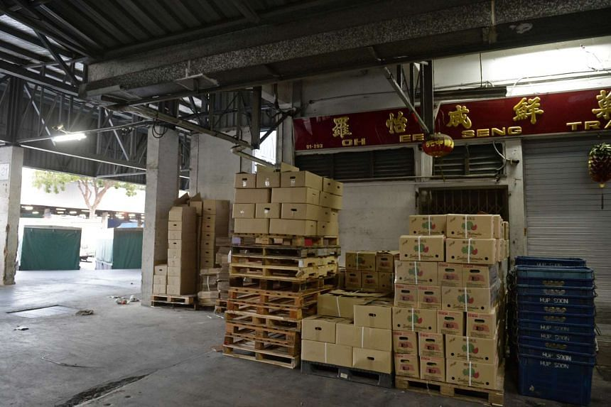 Police recovered about $433,000 in cash and several luxury goods from a room in MBS, where the two Vietnamese men were staying. They allegedly broke into a fruit wholesale shop in Pasir Panjang (above) and stole the money.