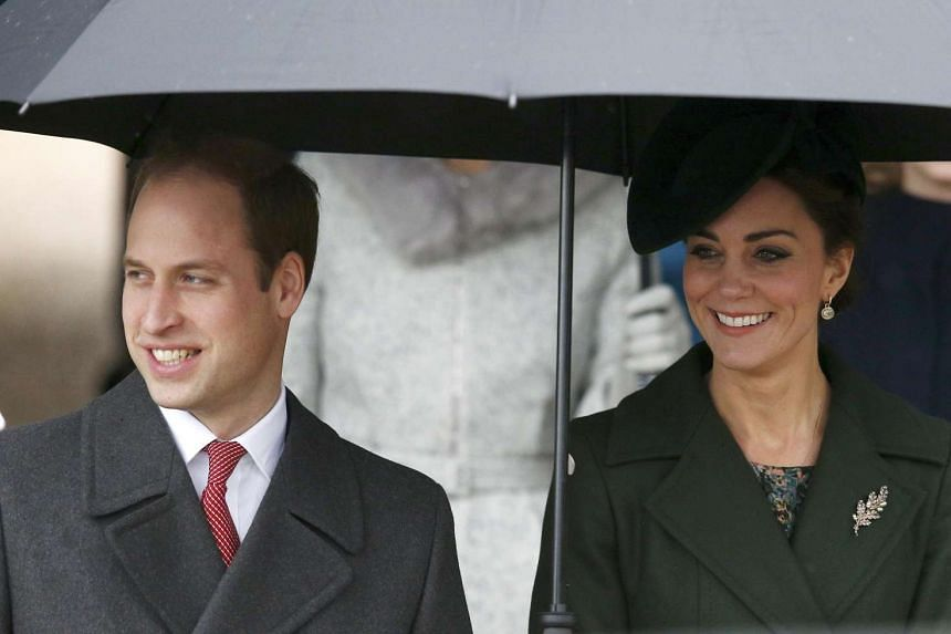Britain's Prince William and his wife Kate leave after attending the Christmas Day service at church in Sandringham, eastern England.