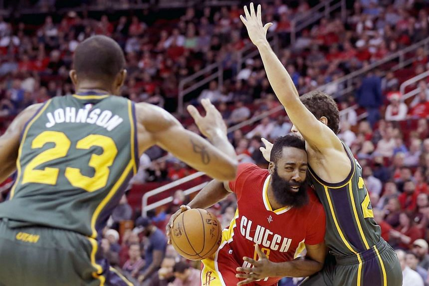 Houston Rockets guard James Harden drives as he splits the defense of Utah Jazz.