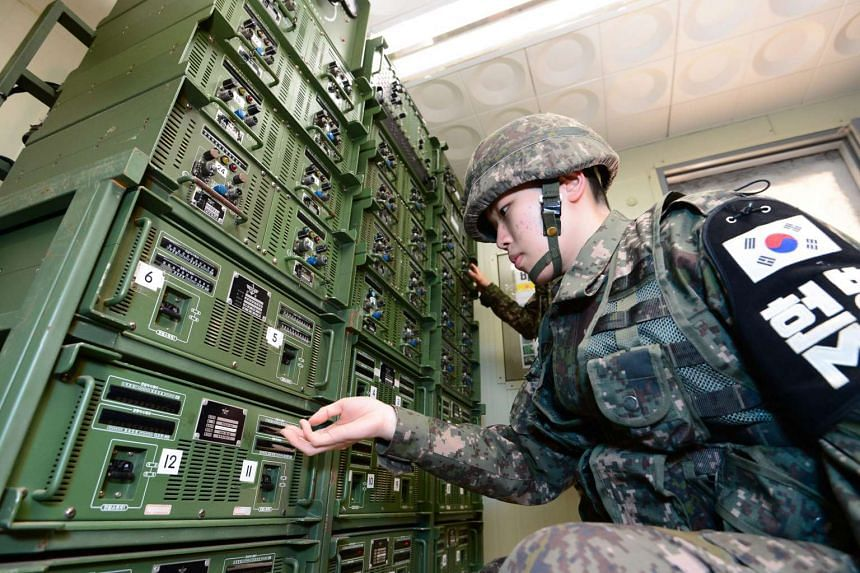 S. Korean soldiers adjusting broadcasting equipment at a control room near the inter-Korean border on Jan 8, 2016.