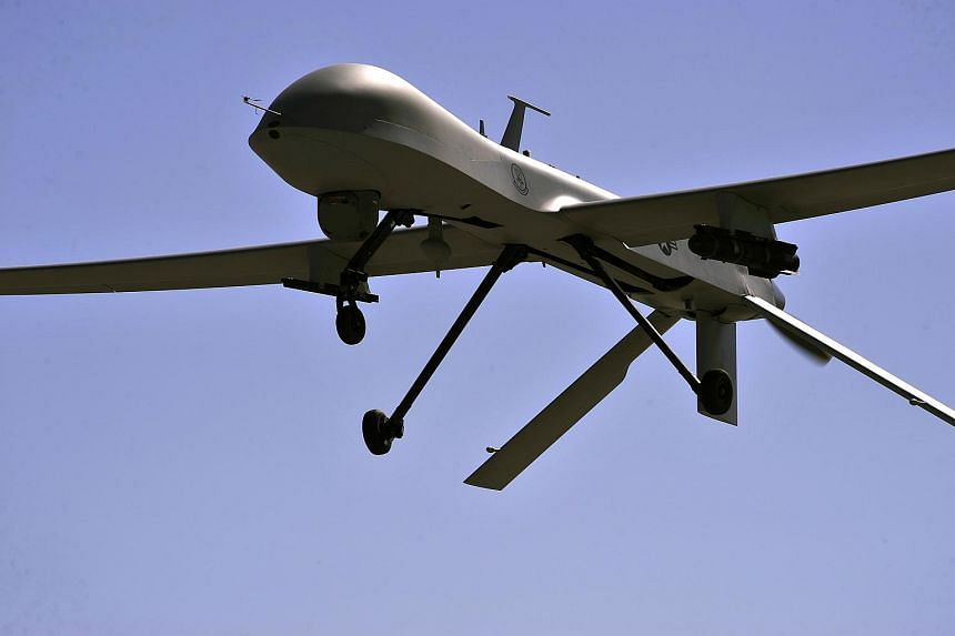 An MQ-1B Predator remotely piloted aircraft flying overhead during a training mission, on May 13, 2013 in Nevada.
