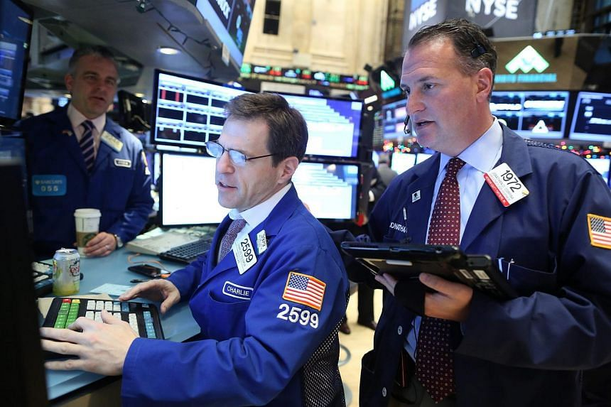 Traders working on the floor of the New York Stock Exchange at the start of the trading day on Jan 7.
