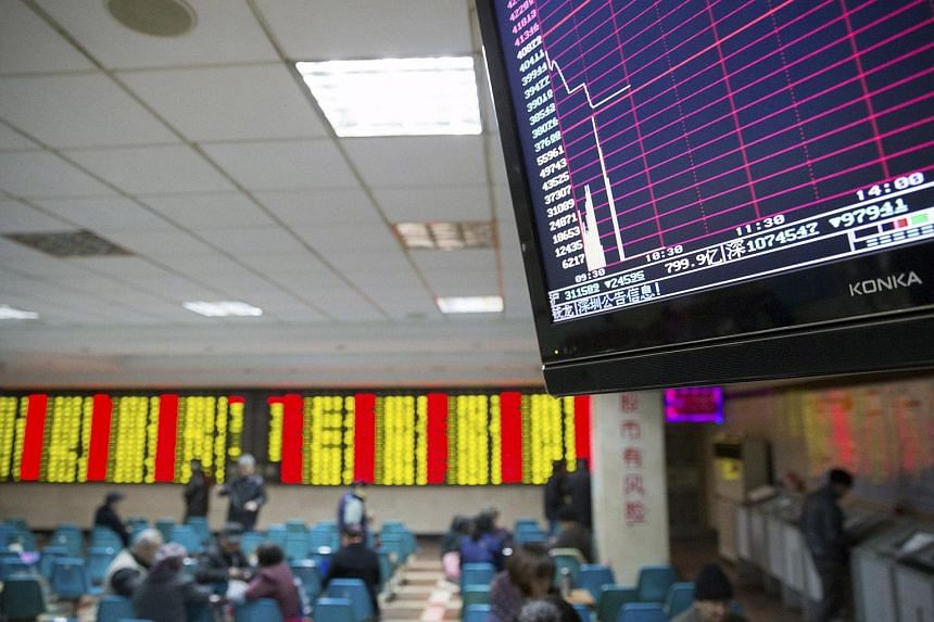 A screen showing the stock information at a brokerage house in Nanjing, China, on Jan 7, 2016