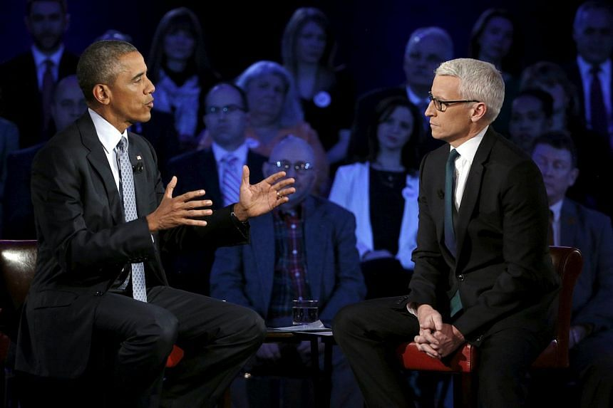 US President Barack Obama participating in a live town hall event on reducing gun violence hosted by CNN's Anderson Cooper (right) on Jan 7, 2016.