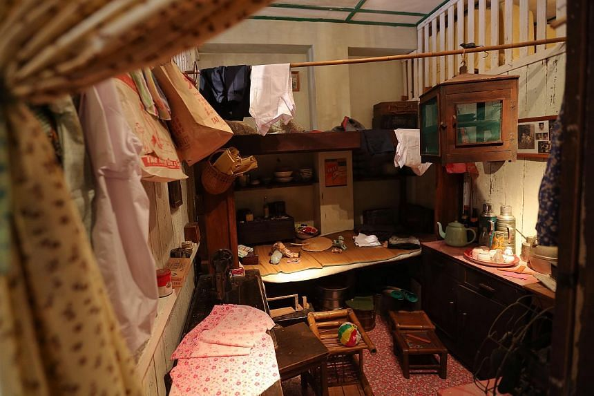 A Family of Eight - The former Painter's Cubicle that gave a glimpse of a typical family life in the shophouse is updated to feature a different family.