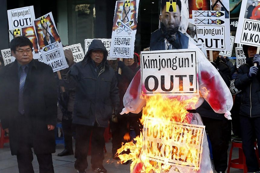 South Korean activists burning an effigy of North Korean leader Kim Jong Un yesterday during a rally in Seoul, after Pyongyang said it tested a hydrogen bomb on Wednesday.