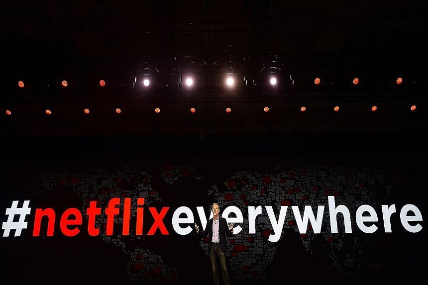 Netflix CEO Reed Hastings giving his keynote address at the Consumer Electronics Show in Las Vegas. Netflix's Singapore launch is part of its push into 130 new nations, on top of the 60 where it already has a presence.