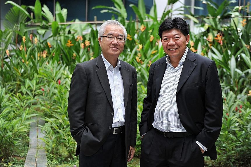 GS Holdings' Mr Foo (right), seen here with executive chairman and CEO Pang Pok, is confident the company will do well and is in for the long term.