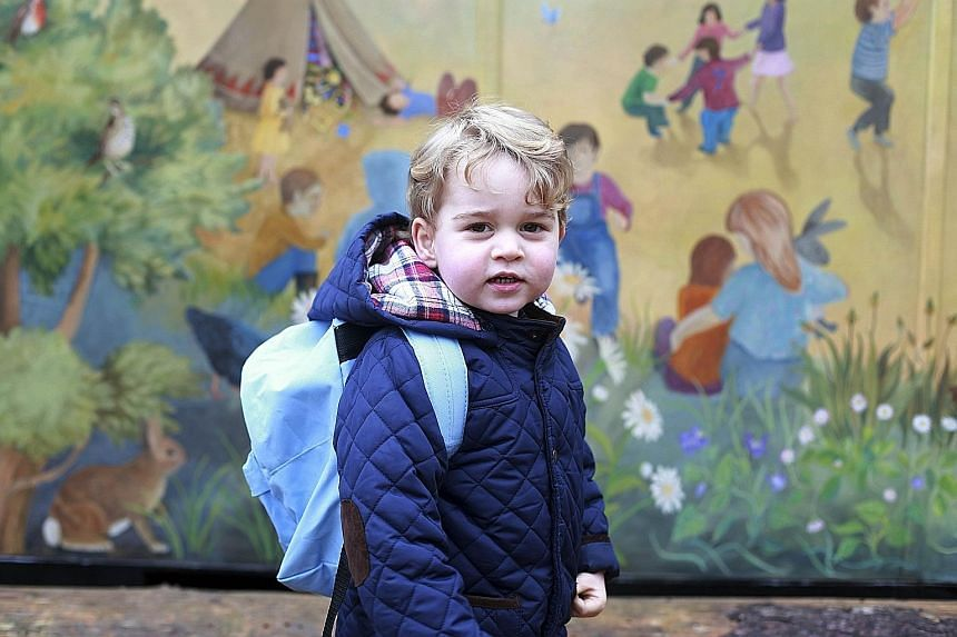 Britain's Prince George arriving for his first day at the Westacre Montessori School Nursery, after being dropped off by his mother Catherine, Duchess of Cambridge, and father Prince William. The two-year-old prince will attend the nursery in Norfolk