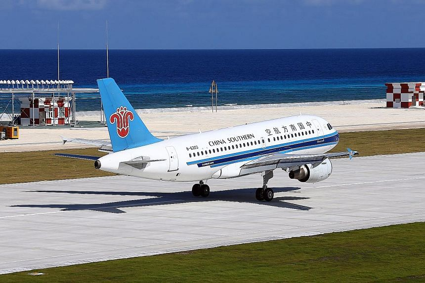 One of the two civilian planes - a China Southern Airlines Airbus - at the airport on Fiery Cross Reef on Wednesday. The two planes had flown from Haikou, the capital of the southern island province of Hainan, and touched down one after the other in
