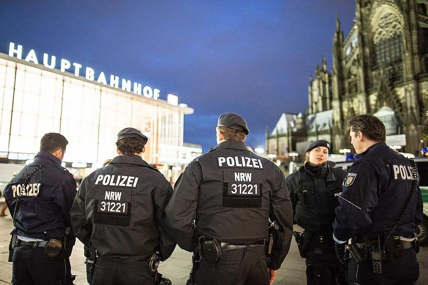 Police officers on duty outside the main train station in Cologne on Wednesday. After sexual assaults on women at New Year's Eve, there is an increased police presence at the station.
