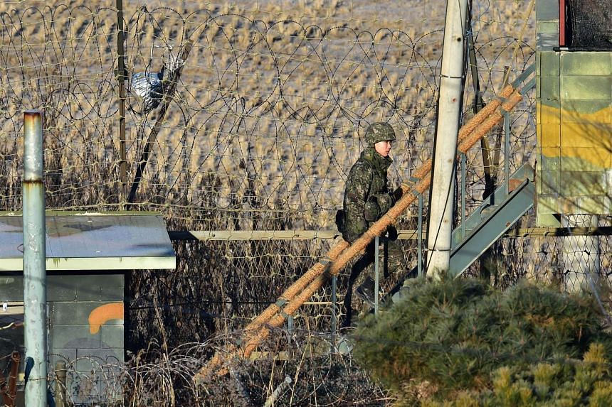 A South Korean soldier walks up to a guard post at a military guard area in the border city of Paju near the Demilitarized zone dividing the two Koreas on Jan 8, 2016.