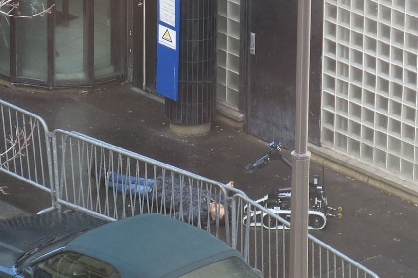 A bomb disposal robot inspecting the body of the man who attacked a police station in Paris on Jan 7.