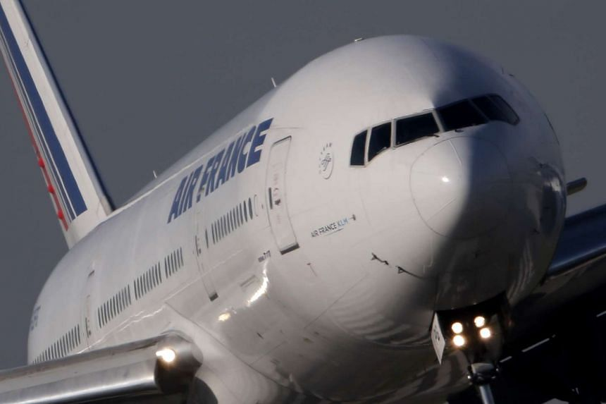 An Air France Boeing 777 aircraft lands at Charles de Gaulle International Airport in Roissy, near Paris.