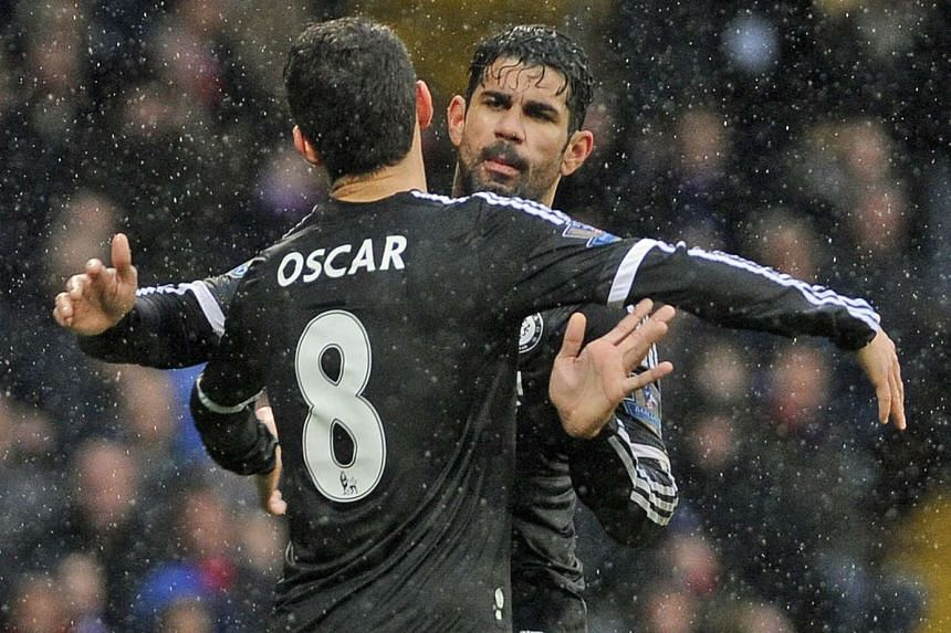 Chelsea's Oscar and Diego Costa celebrate a goal against Crystal Palace on Jan 3, 2016.