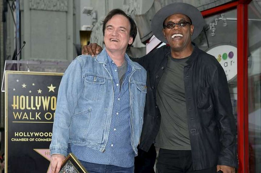 Film-maker Quentin Tarantino (left) posing on top of his star with actor and event emcee Samuel L. Jackson after he was honoured on the Hollywood Walk of Fame last month.