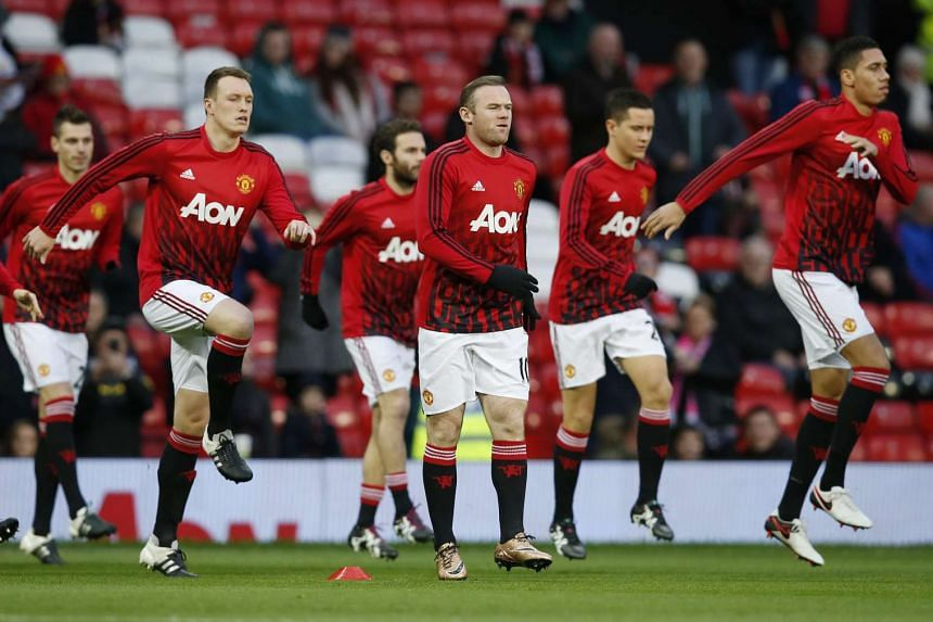 Manchester United players warm up before their match against Swansea City on Jan 2, 2015.