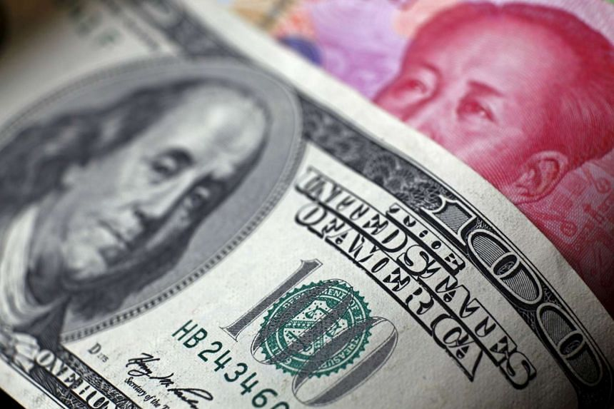 China's foreign exchange regulator has ordered banks in some hubs to limit the US dollar buying this month.