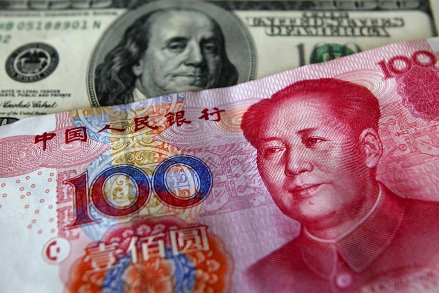 A yuan banknote is displayed with a US dollar banknote (back).