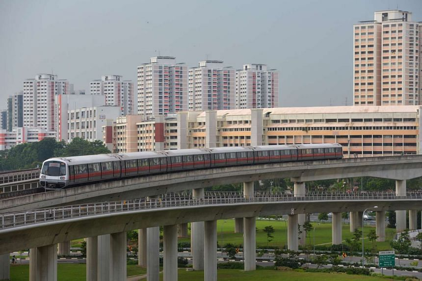 A file photo of an MRT train moving towards Jurong East MRT station.