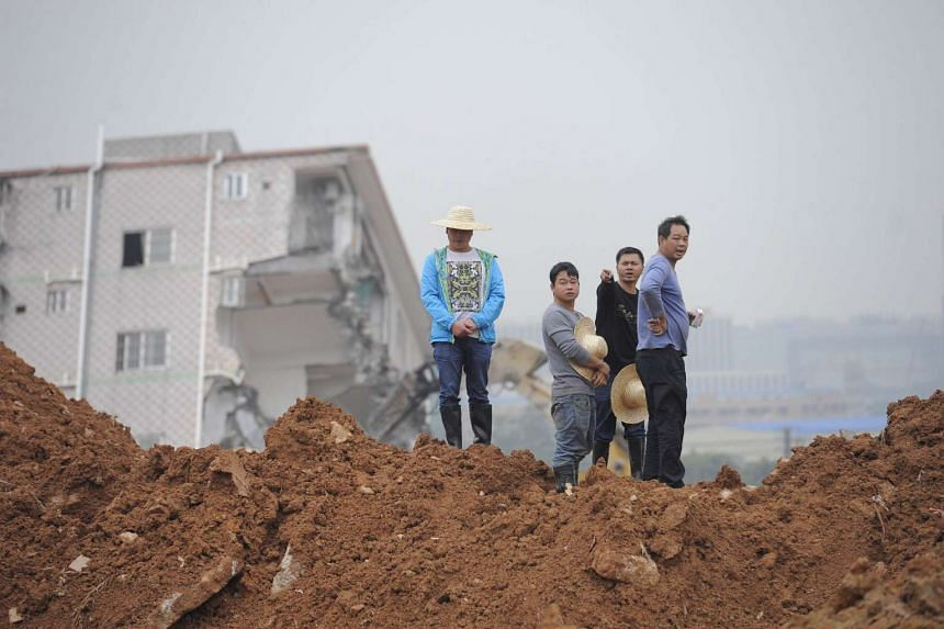 Men from central China's Hunan province looking for their missing relatives at the site of the Shenzhen landslide on Dec 22, 2015.
