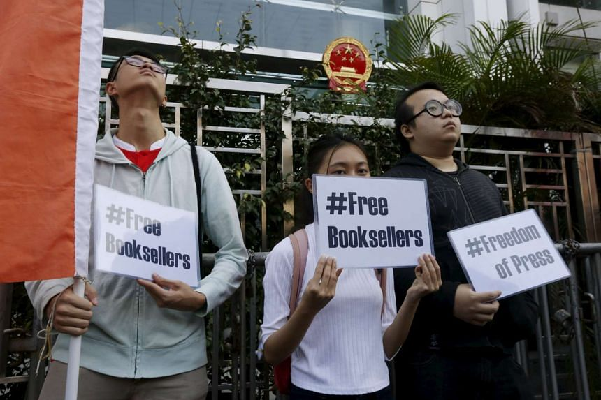 Members of student group Scholarism holding up placards during a protest about the disappearances of booksellers in Hong Kong on Jan 6, 2016.