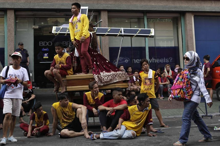Devotees waiting for the start of a procession of Black Nazarene replicas two days before the annual parade in Manila.