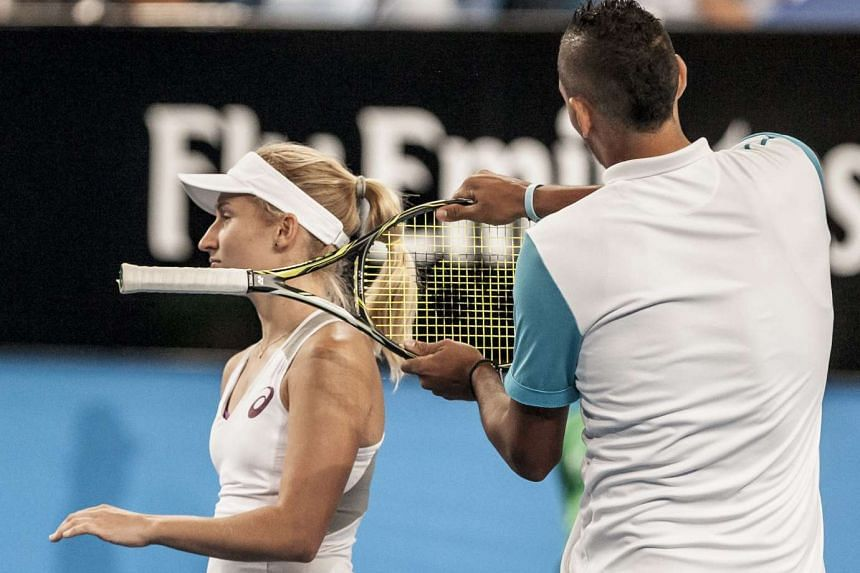 Nick Kyrgios pretending to hit Daria Gavrilova with his raquet during a Hopman Cup match on Jan 8, 2016.