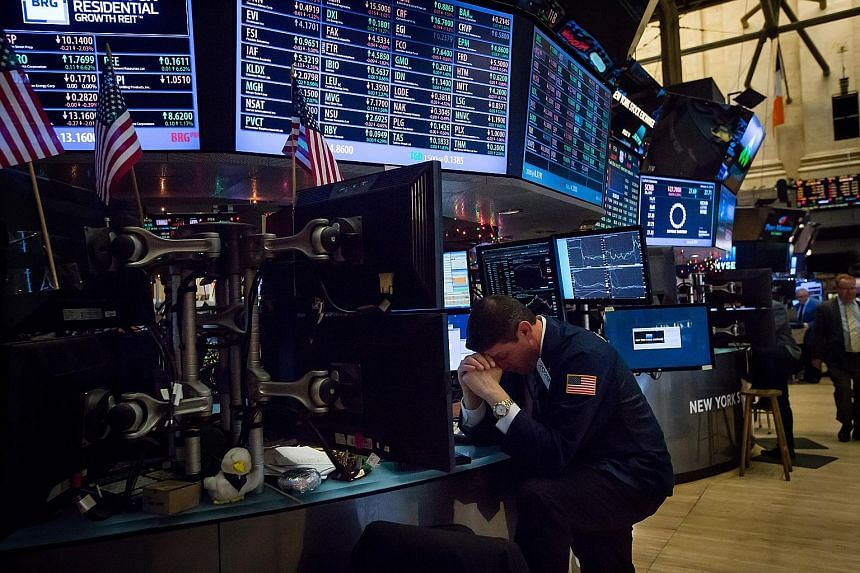A trader on the floor of the New York Stock Exchange on Monday. Over the first four days of this week, more than US$4 trillion was wiped from the value of global equities.