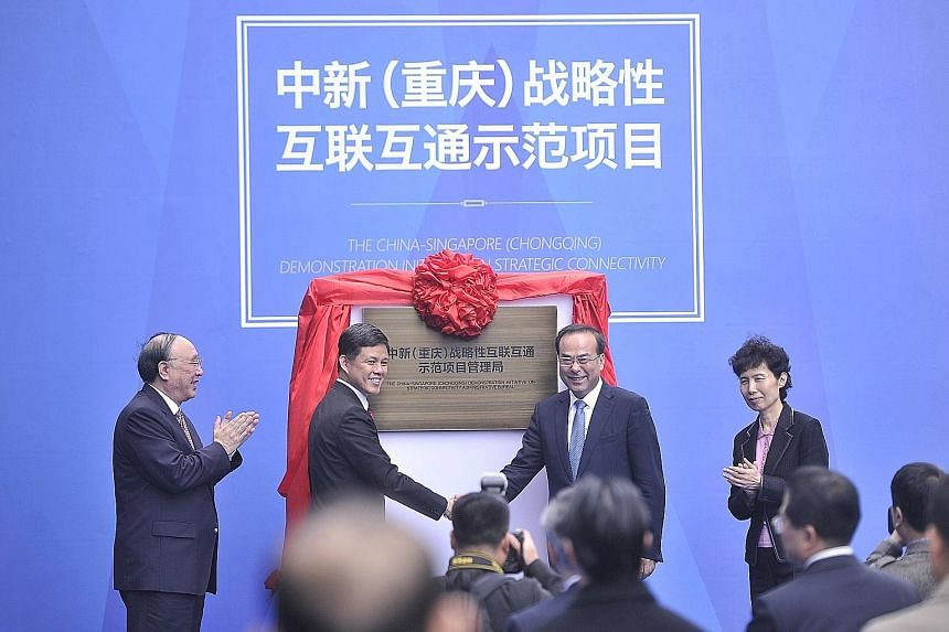 Singapore's labour chief Chan Chun Sing (second from left) and Chongqing party chief Sun Zhengcai (third from left) unveiled a plaque for the third Sino-Singapore project's administrative committee office at an outdoor ceremony yesterday in Chongqing