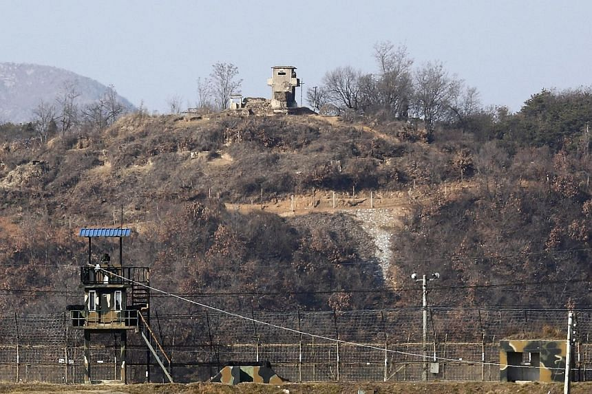 South Korean tanks moving near the demilitarised zone at Paju in Gyeonggi province yesterday as the military shored up defences near loudspeakers blasting propaganda aimed at the North.